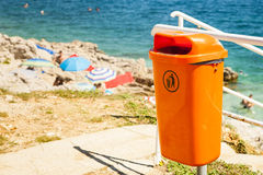 Trash can near the sea beach. Stock Image