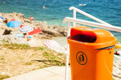 Trash can near the sea beach. Stock Photo
