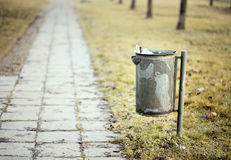 Trash can and pathway Royalty Free Stock Image