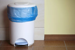 Trash can with a plastic bag inside Stock Photo