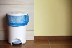 Trash can with a plastic bag inside Royalty Free Stock Photo
