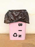 Trash can with a plastic bag Royalty Free Stock Photo
