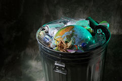 Trash Can with Rubish and Earth Royalty Free Stock Photos