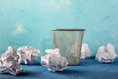 Trash can with scattered papers around. Beautiful background with place for text. Empty bin. Royalty Free Stock Photo