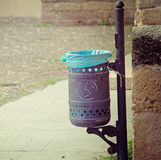 Trash can in a small square. Processed for vintage tone effect stock images