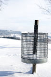 Trash can in the snow, concept winter tourism Stock Photography