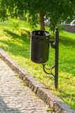 Trash can on the street. A metal street trash can in the park stock image