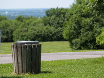 Trash can with a view. A trash can on a hilltop in a park on the grass Royalty Free Stock Photos