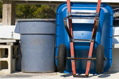 Trash Can and Wheel Barrel Royalty Free Stock Image