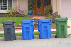 Trash Cans. Containers for trash, recycling and yard waste Royalty Free Stock Images