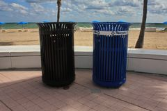 Trash Cans on Beach Stock Image