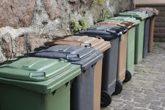 Trash cans in a row Royalty Free Stock Photography