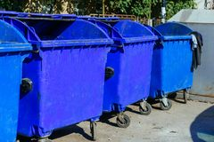 Trash cans standing in a row. Bin Many blue tanks Stock Image