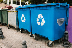 Trash cans standing in a row. Garbage containers standing in a row. Waste storage Royalty Free Stock Photos