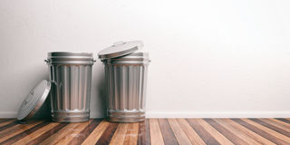 Trash cans on a wooden floor 3d illustration. Two trash bins on a wooden floor. 3d illustration Stock Photography
