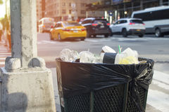 Trash with cars in background on busy city street new york. Trash with cars in background on busy city street Royalty Free Stock Photography