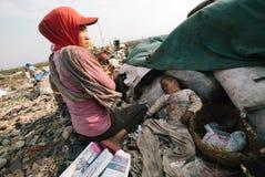 Trash city. A baby sleeping on top of trash Stock Image