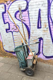 Trash cleaning cart with bin and broom standing on the street Stock Images