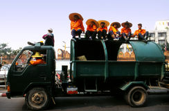 Trash collectors waiting at the Flower Carnival Stock Photography