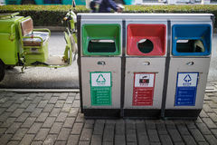 Trash on concrete outdoors in the city. Big containers for recycling waste sorting - Recyclable garbage, hazardous waste, other garbage Stock Photos