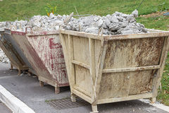 Trash container full of concrete debris Royalty Free Stock Photo
