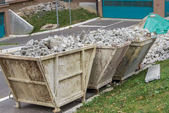 Trash containers full of concrete debris Royalty Free Stock Images