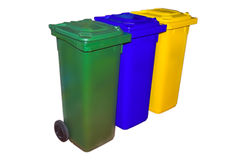 Trash Containers for Garbage Separation. Three colors for plastic, metal and burnables Royalty Free Stock Image