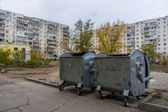 Trash containers in Kyiv`s ghetto royalty free stock image