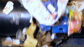 Trash on a conveyor at a recycling plant. No people. stock footage