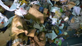 Trash on a conveyor at a recycling plant. No people. stock video footage
