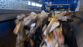 Trash conveyor system. Garbage moving on a conveyor belt. stock video footage