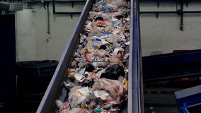 Trash conveyor working at a trash recycling plant. stock video