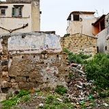 Trash and crumbling wall in a Palermo neighborhood. Sicily, Italy stock images