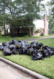 Trash Day. A home has many bags of garbage to be picked up for trash day Stock Image