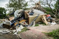 Trash and debris outside of Houston homes. Devastated after Hurricane Harvey stock photos