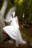 Trash the dress in autumn forest Royalty Free Stock Photo