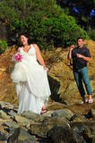 Trash the dress - Happy bride and groom blowing bu Stock Image