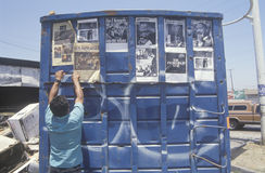 Trash dumpster used as community bulletin board, South Central Los Angeles, California Stock Images