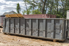 Trash dumpsters on construction site Stock Photo