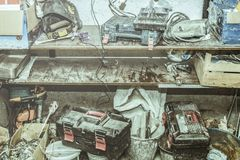 Trash in the garage, piled up different old things royalty free stock photo