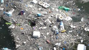 Trash and garbage floating on the surface of the water. Water pollution with dirt and plastic garbage floating on the surface of the sea stock video footage