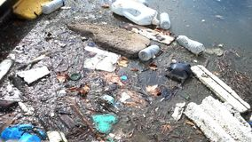 Trash and garbage floating on the surface of the water. Water pollution with dirt and plastic garbage floating on the surface of t