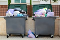 Trash garbage full container in street. Trash garbage full of bags container in street Royalty Free Stock Image