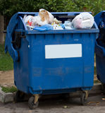 Trash garbage full container in street Royalty Free Stock Photo