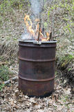 Trash and Garbage in Old Rusty Burning Barrel Stock Images