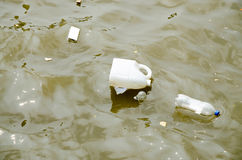 Trash and Garbage in water Royalty Free Stock Images