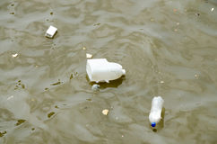 Trash and Garbage in water Royalty Free Stock Image