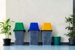 Trash Green, Blue, Yellow. Used for sorting. Inside the building stock images