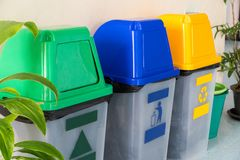 Trash Green, Blue, Yellow. Used for sorting. Inside the building stock photography
