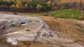 Trash from household waste. Garbage trucks carry garbage to a landfill, top view.